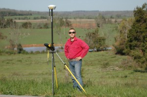 surveyor out in field with equipment