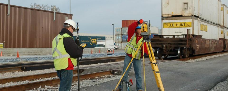 surveyors working near train