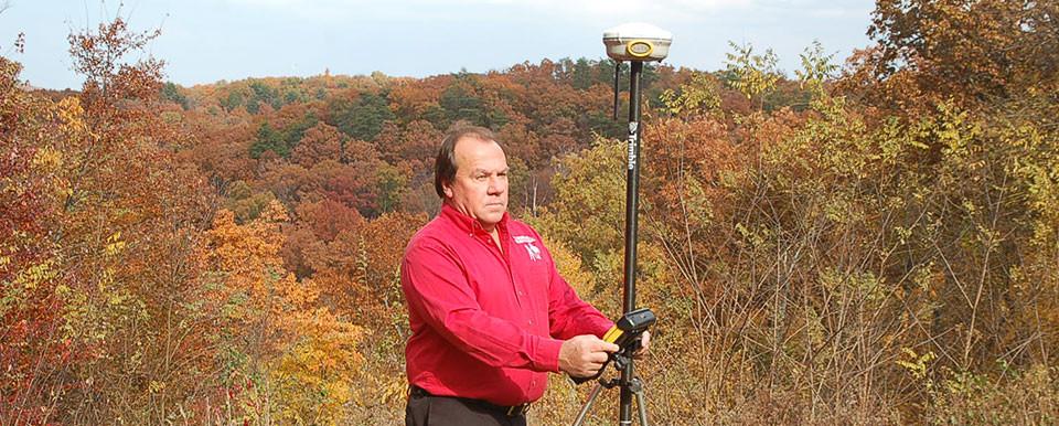 Richard surveying with GPS